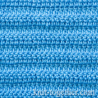 And here is how looks a fabric made of extended double crochet stitches.